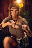 Mulher do guerreiro com faca do combate fotografia de stock royalty free