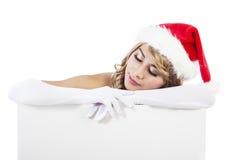 Mulher do Natal com bandeira do sinal Foto de Stock Royalty Free