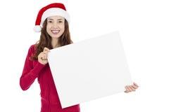 Mulher do Natal com uma placa do sinal Foto de Stock Royalty Free