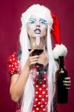 Mulher do Natal com vinho Fotografia de Stock Royalty Free