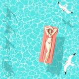 Mulher do Natal no colchão de ar no mar Foto de Stock Royalty Free