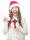 Mulher do Natal que aponta acima Fotos de Stock