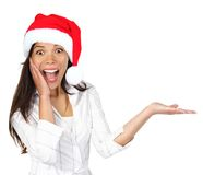 Mulher do Natal que apresenta o produto Imagem de Stock Royalty Free