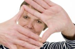 Mulher do oler do quadro da mão foto de stock royalty free