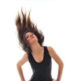 Mulher do partido isolada com vento no cabelo Fotos de Stock