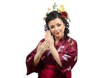 Mulher do quimono que mostra gestos tradicionais Fotos de Stock Royalty Free
