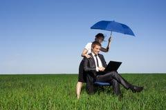 A mulher do seguro no campo Imagens de Stock Royalty Free