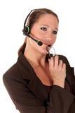 Mulher do serviço de atenção que comunica-se Imagens de Stock