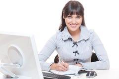 Mulher do smiley no escritório imagens de stock