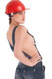 Mulher do trabalhador novo na combinação das calças de brim Fotos de Stock