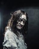 Mulher do zombi com cara ensanguentado imagens de stock royalty free