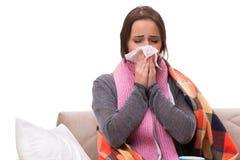 A mulher doente que encontra-se no sofá foto de stock royalty free