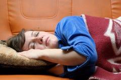 A mulher dorme no descanso Imagem de Stock Royalty Free