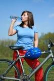 Mulher e bicicleta Imagens de Stock Royalty Free