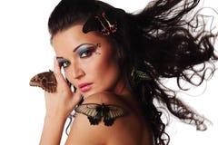 Mulher e borboleta Foto de Stock Royalty Free