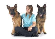 Mulher e cães Foto de Stock Royalty Free
