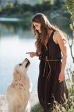 Mulher e cão Foto de Stock