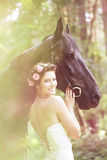 Mulher e cavalo fotografia de stock royalty free