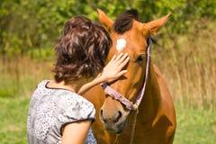 Mulher e cavalo Fotografia de Stock
