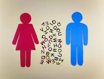 Mulher e contorno masculino com letras do alfabeto entre elas imagem de stock