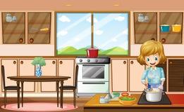Mulher e cozinha Fotos de Stock Royalty Free