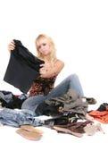 Mulher e ela roupa Fotografia de Stock