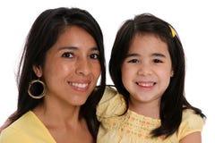 Mulher e filha no fundo branco fotos de stock