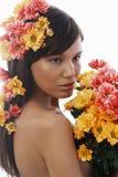 Mulher e flores bonitas Fotos de Stock Royalty Free