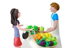 Mulher e greengrocer Imagem de Stock