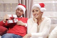 Mulher e homem no Natal Fotografia de Stock