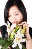 Mulher e lírio asiáticos Imagem de Stock Royalty Free