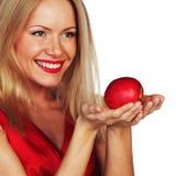 Mulher e maçã vermelha fotografia de stock royalty free