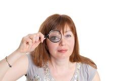Mulher e magnifier fotos de stock royalty free