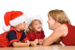 Mulher e miúdos que têm o divertimento Fotografia de Stock Royalty Free