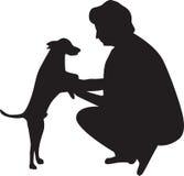 A mulher e o cão mostram em silhueta o vetor Imagem de Stock
