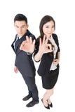 A mulher e o homem de negócio dão-lhe um sinal aprovado Fotografia de Stock Royalty Free
