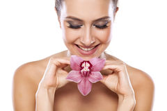 Mulher e orquídea imagem de stock