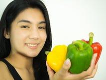 Mulher e pimenta asiáticas Imagens de Stock Royalty Free