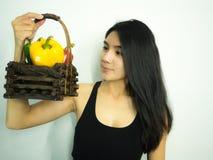 Mulher e pimenta asiáticas Imagem de Stock Royalty Free