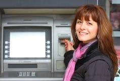 Mulher e um ATM Imagens de Stock