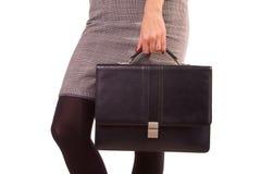 Mulher e um couro preto imagem de stock royalty free