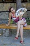 Mulher e ventilador Fotos de Stock Royalty Free