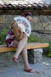 Mulher e ventilador Imagens de Stock