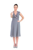 A mulher elegante alegre no vestido elegante manuseia acima Imagens de Stock
