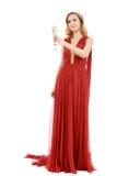 Mulher elegante bonita no vestido vermelho com um vidro do champanhe c foto de stock royalty free