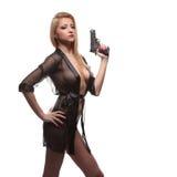 Mulher elegante elegante com uma arma nas mãos Imagem de Stock