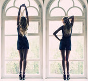 A mulher elegante levanta o comprimento completo no peitoril da janela Foto de Stock Royalty Free