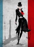 A mulher elegante vai abaixo da rua, outono Imagem de Stock Royalty Free