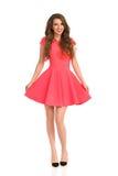 Mulher em Mini Front View cor-de-rosa Imagens de Stock Royalty Free