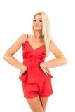 Mulher em pijamas vermelhos Fotos de Stock Royalty Free
